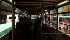 First person view from rear deck of tram, slowly drive through Hong Kong street Stock Footage