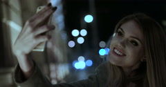 Happy woman taking selfie on the phone walking evening time  Stock Footage