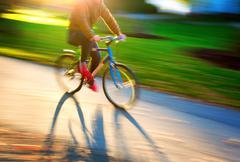Man on bike - stock photo