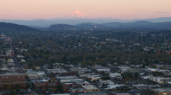 Stock Video Footage of City of Portland, Oregon with Mt. Hood in distance, aerial video at dusk: 4K