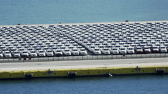Port terminal,hundreds of imported brand new vehicles parked Stock Footage