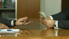 Corruption. Businessman in a suit takes a bribe - stock footage