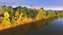 Aerial Flyover of Colorful Autumn Foliage at Picturesque Rivers Edge Stock Footage