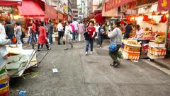 POV walk to Bowrington Road Wet Market colourful red fruit stalls Stock Footage