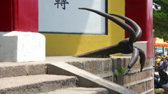 An anchor at the entrance of the Yingjiang Temple located in Anqing, China Stock Footage