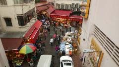 Slide shot above Wan Chai road look at intersection with Bowrington Rd Market Stock Footage
