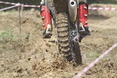 Enduro racer on the track Stock Photos