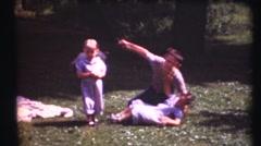 1948  ,Three children playing in backyard Stock Footage