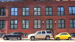 Establishing shot of a brownstone brick office building in Brooklyn's dumbo Stock Footage