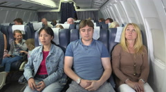 Stock Video Footage of Smelly passenger on plane with poor personal hygiene