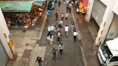 Backstreet people pass through, high angle shot, tilt down, track pedestrians Stock Footage