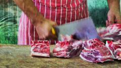 Butcher cuts meat at the supermarket Stock Footage