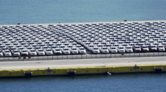 4K Port terminal,hundreds of imported brand new vehicles parked Stock Footage