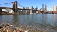 Water level establishing shot of New York City financial district with Brooklyn Stock Footage
