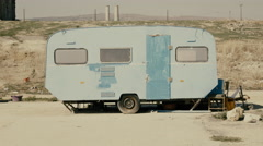 4K Rickety old vintage abandoned caravan/trailer in a deserted camp/area Stock Footage