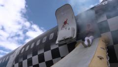 Passengers use emergency exit slide to leave burning plane Stock Footage