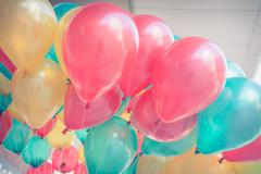 Stock Photo of colorful balloons with happy celebration party background