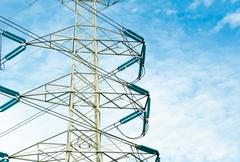 High voltage transmission lines isolated on blue sky background Stock Photos