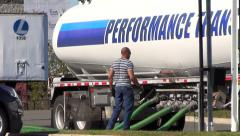 Gas fuel truck fills stations underground tanks Stock Footage
