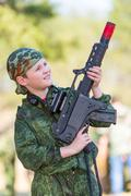 Boy with a gun playing lazer tag - stock photo