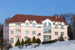 Nice apartment building at winter time Stock Photos