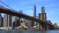 Establishing shot of New York City with Brooklyn Bridge, Freedom Tower, and East Stock Footage