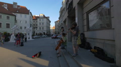 Playing string instruments in Franz Kafka Square, Prague Stock Footage