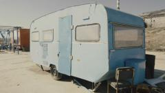 4K Rickety old vintage abandoned caravan/trailer in a deserted camp/area - stock footage