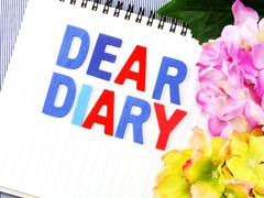 dear diary word on white paper notebook concept background - stock photo