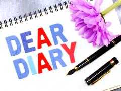 Dear diary word on white paper notebook concept background Stock Photos