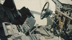 Stock Video Footage of Abandoned dismantled car interior,stolen,theft,post dolly tracking.