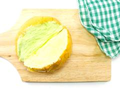 top view of slices bread with butter on a rustic wooden cutting board wooden  - stock photo