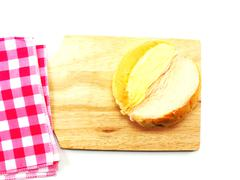 Top view of slices bread with butter on a rustic wooden cutting board wooden  Stock Photos