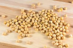 Soybean or yellow bean seed on wood background - stock photo