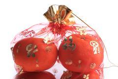 orange fruit of fortune in chinese new year celebration, isolated on white ba - stock photo