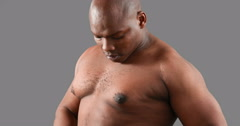 Muscular man measuring his body mass - stock footage