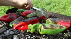 Young woman hand preparing roasted vegetables peppers on barbecue grill Stock Footage