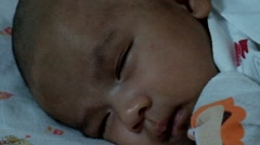 Close-up portrait of a beautiful sleeping baby in white blanket Stock Footage