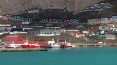 Greenland small town Qaqortoq 104 colorful town at hillside seen from sea Stock Footage