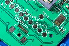 Macro closeup of a green PCB Board - stock photo