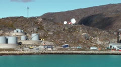 Greenland small town Qaqortoq 103 smooth pan along industrial zone and harbor Stock Footage