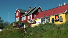 Greenland small town Qaqortoq 100 colorful houses on green hill Stock Footage