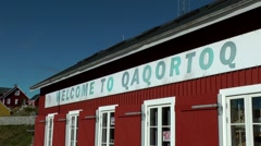 Greenland small town Qaqortoq 098 souvenir shop with welcome banner Stock Footage