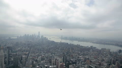 Stock Video Footage of Helicopter flying over the Empire State Building