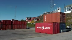 Greenland small town Qaqortoq 099 carrier vehicle stacks container in harbor Stock Footage