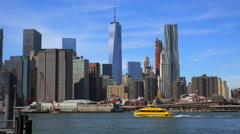 New York water taxi crossing the East River from Manhattan Financial District to Stock Footage