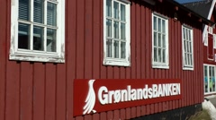 Greenland small town Qaqortoq 093 simple building of Greenlandic bank Stock Footage