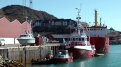 Greenland small town Qaqortoq 092 pier with red colored ships and boats Stock Footage