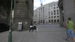 Tourists walking and man playing the guitar near the Powder Tower, Prague Stock Footage
