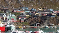 Greenland small town Qaqortoq 076 yellow tender boat crosses idyllic harbor Stock Footage